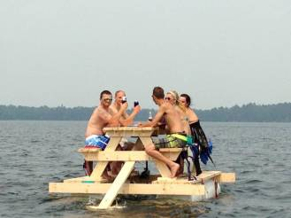 party-barge-picnic-table-equipped-with-motor-pontoon-floats